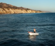Man on boat north of Santa Barbara, Gaviota State Park